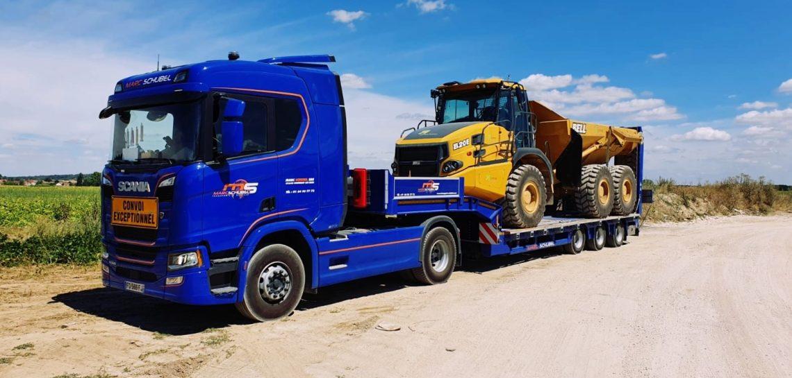 Camion plateau porte-engin de chantier Crawler TP
